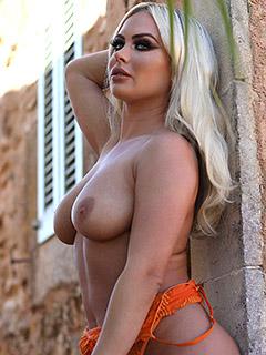 Sara Lou in Orange Bodysuit