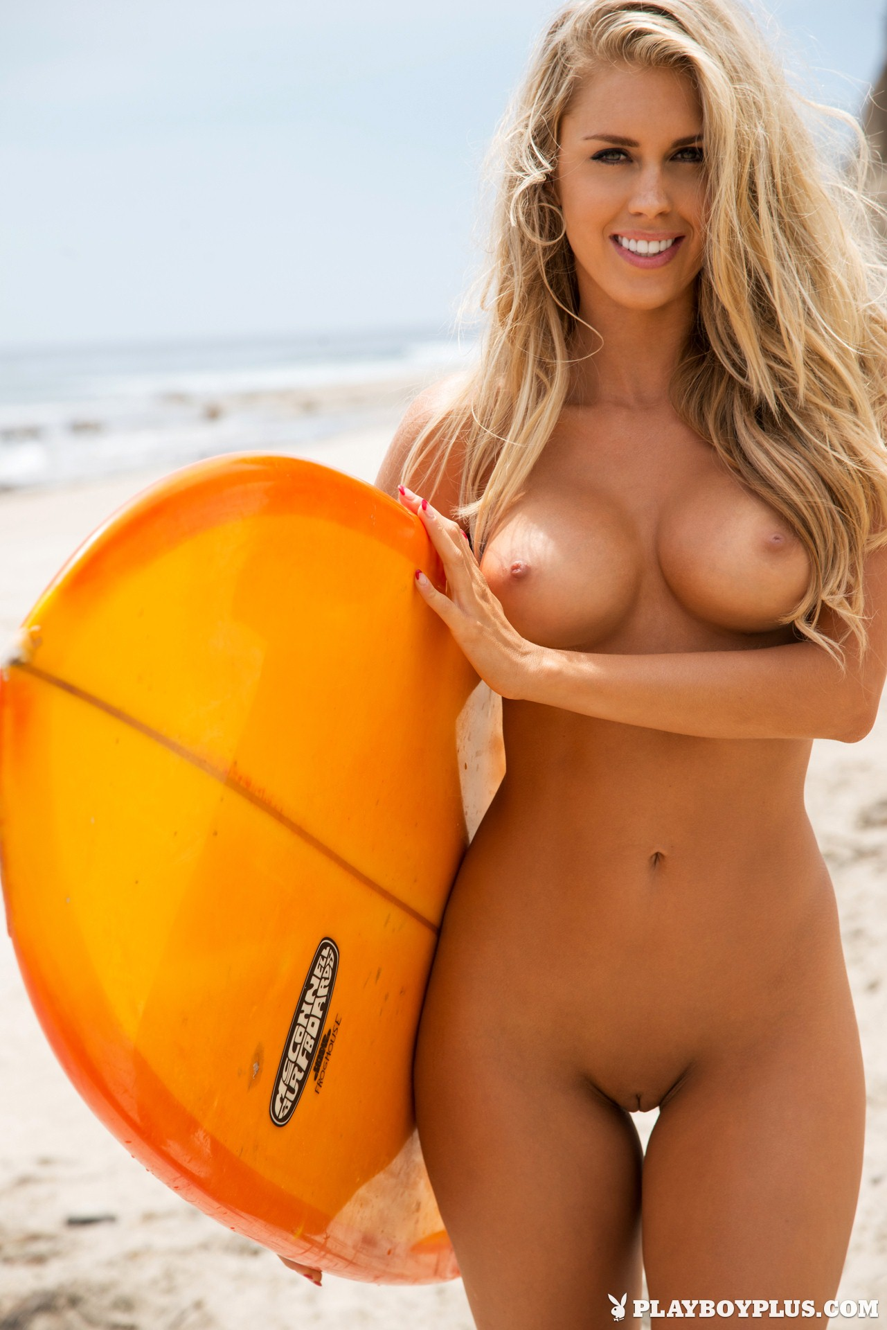 Surfer girl surfing